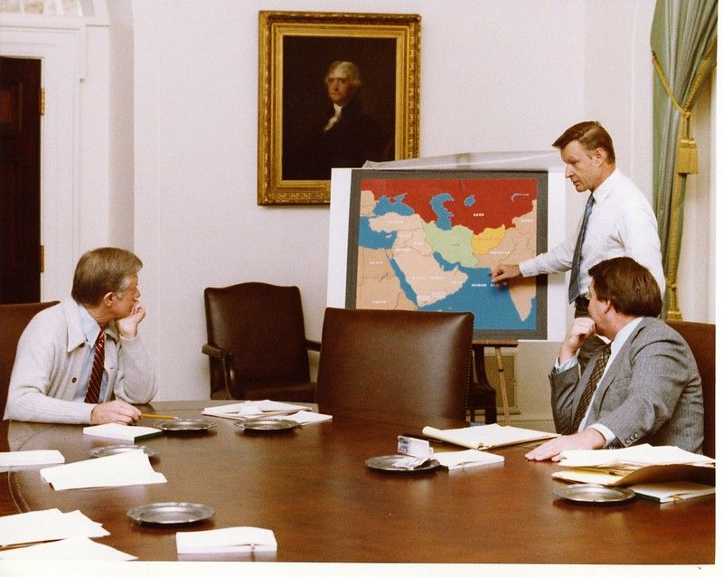 President Jimmy Carter receives a briefing about the Iran hostage crisis.