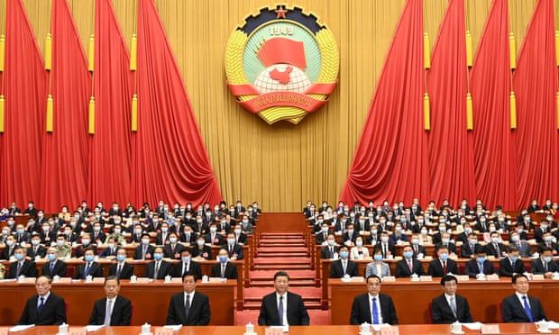 Li Keqiang (front row, third from right) with Xi Jinping (centre) at the opening of the national congress in Beijing on Friday. Photograph: Xinhua/REX/Shutterstock via The Guardian.